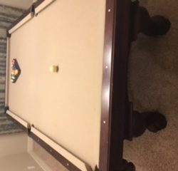 Pool table and pool stick/cue holder